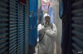 A cleaning worker wearing personal protective equipment disinfects the Merced Market in Mexico City, on April 02, 2020. - More…