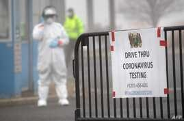 STAMFORD, CT - MARCH 20: A sign sits on a barrier at a coronavirus (COVID-19) drive thru testing location operated by Murphy…
