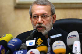 (FILES) In this file photo taken on February 17, 2020, Iranian Parliament Speaker Ali Larijani gives a press conference at the…