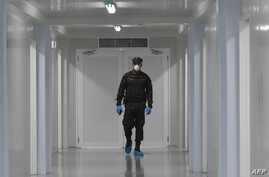 """An Institutional Protection Service staffer walks during the inauguration of the new """"Panama Solidario"""" Integrated Hospital for…"""