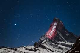 A picture taken on late April 1, 2020 from the alpine resort of Zermatt shows the iconic Matterhorn mountain located on the…