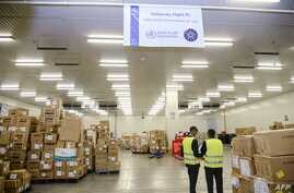 Boxes containing mostly personal protective equipment (PPE), are seen at Ethiopian Airlines' cargo facility at Bole…