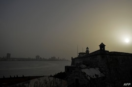 View of Morro Castle as a vast cloud of Sahara dust is blanketing the city of Havana on June 24, 2020. - A massive cloud of…