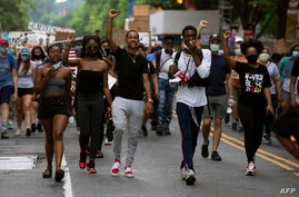 Demonstrators march near the White House, to protest police brutality and racism, on June 10, 2020 in Washington, DC. -…