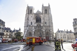Firefighters are at work to put out a fire at the Saint-Pierre-et-Saint-Paul cathedral in Nantes, western France, on July 18,…