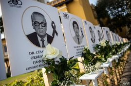 TOPSHOT - Images of the 125 doctors who have died during the COVID-19 pandemic in Peru, are displayed outside Peru's Medical…