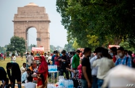 People gather at a park near India Gate to celebrate the country's 74th Independence Day in New Delhi on August 15, 2020. …