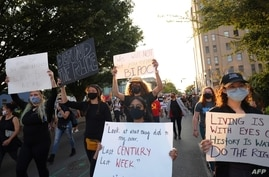 LOUISVILLE, KENTUCKY - SEPTEMBER 26: People march for the third day since the release of the grand jury report on the death of…