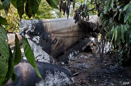 Handout picture released by Guatemala's Army press office showing rubble after a plane carrying drugs crashed in Santa Marta…