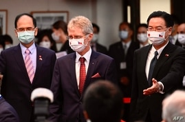Czech Senate speaker Milos Vystrcil (C) is escorted by Taiwan's Foreign Minister Joseph Wu (R) and Parliament Speaker Yu Shyi…