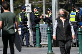 Police patrol a street in Melbourne on September 6, 2020 as the state announced an extension to its strict lockdown law while…