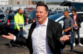 (FILES) In this file photo taken on September 03, 2020, Tesla CEO Elon Musk arrives to visit the construction site of the…
