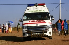 An ambulance drives in a border reception centre (Village 8), housing Ethiopian refugees who fled the fighting in Tigray Region…