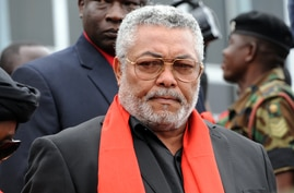 (FILES) In this file photo taken on August 08, 2012 Former President Jerry Rawlings of Ghana arrives to pay last respect to…