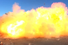 This SpaceX video frame grab image shows SpaceX's Starship SN8 rocket prototype crashing on landing at the company's Boca Chica…