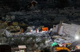 Rescue workers are seen at the landslide in Ask, Gjerdrum, on Jan. 3, 2021.