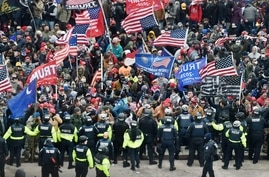 Trump supporters clash with police and security forces as they storm the US Capitol in Washington, DC on January 6, 2021. -…