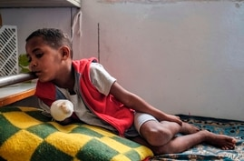 Abel Guesh, 8-years-old, rests on his bed at the Ayder Referral Hospital in the Tigray capital Mekele on February 25, 2021,…