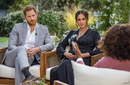 This undated image released March 7, 2021 courtesy of Harpo Productions shows Britain's Prince Harry (L) and his wife Meghan (C…