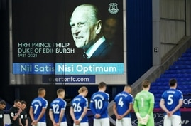 Players observe a minute silence in honour of Britain's Prince Philip, Duke of Edinburgh, on the eve of his funeral, ahead of…