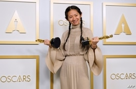 """TOPSHOT - Chinese Director/Producer Chloe Zhao, winner of the award for Picture and Director for """"Nomadland,"""" poses in the…"""