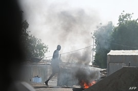 Smoke billows from burning tyres in the street during clashes between opposition demonstrators and Chadian police in N'Djamena…