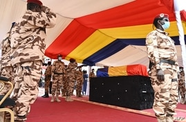 Chad army officers pay tribute to late Chadian President Idriss Deby Itno during the state funeral in N'Djamena on April 23,…
