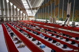 Muslims offer a prayer at the Grand Faisal Mosque in Islamabad amid the Covid-19 coronavirus pandemic, May 3, 2021.