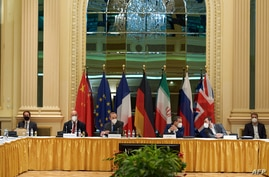 (FILES) In this handout photo taken released on May 1, 2021 by the EU Delegation in Vienna shows delegation members from the…