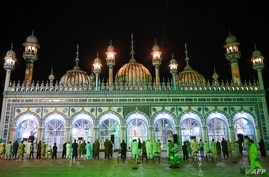 In this picture taken on May 5, 2021, devotees offer  'Taraweeh' evening prayer at the Markazi Jamia mosque