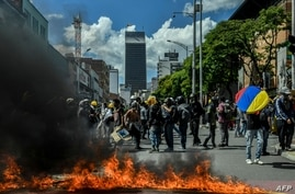 Demonstrators block a street during a protest against the government in Medellin, Colombia, June 28, 2021.