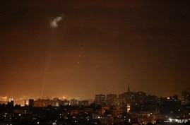 Shootings from the Palestinian territory light-up the night sky in Gaza city, on July 3, 2021, in response to the bombing of…