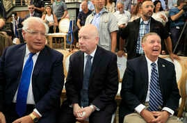U.S. Ambassador to Israel David Friedman, left, White House Mideast envoy Jason Greenblatt, center, and Lindsey Graham, U.S. Senator from South Carolina, attend the opening of an ancient road at the City of David, a popular archaeological and…