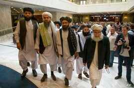 In this file photo taken on Tuesday, May 28, 2019, Mullah Abdul Ghani Baradar, the Taliban group's top political leader, third from left, arrives with other members of the Taliban delegation for talks in Moscow, Russia.
