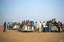 FILE - Nigeriens and third-country migrants head towards Libya from Agadez, Niger on Monday, June 4, 2018.