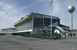 FILE - This March 30, 2004 file photo, shows the grand stands at Vernon Downs in Verona, N.Y. A smaller Woodstock 50 festival could possibly be held at the upstate New York harness track and casino. Town of Vernon Supervisor Randy Watson tells the…