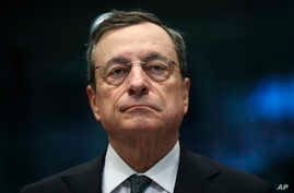 FILE - In this May 16, 2019 photo, European Central Bank President Mario Draghi arrives for a meeting of Eurogroup Finance Ministers at the European Council headquarters in Brussels.