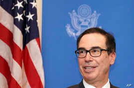 Steven Mnuchin, U.S. Treasury Secretary speaks to media at the venue of G20 Finance Minister and Central Bank Governors Meeting Saturday, June 8, 2019, in Fukuoka, western Japan. (AP Photo/Eugene Hoshiko)