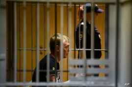 Ivan Golunov, a journalist who worked for the independent website Meduza, sits in a cage in a court room in Moscow, Russia, Saturday, June 8, 2019. A prominent Russian investigative reporter who was detained on drug-dealing charges has been released…