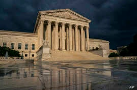FILE -  The Supreme Court is seen under stormy skies in Washington.