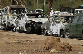 Burned cars remain at the square where the military cleared the opposition sit-in camp on June 3, in Khartoum,  June 17, 2019. Sudan's protest leaders called Monday for nighttime demonstrations and marches in the capital, Khartoum.