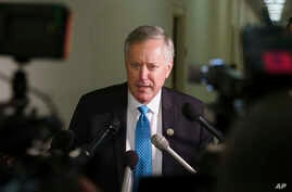 FILE - Rep. Mark Meadows, R-N.C., speaks to media on Capitol Hill in Washington as lawmakers clashed over science, ethics and politics at a House hearing, Dec. 13, 2018.
