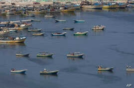 Palestinian fishing boats moored in the Gaza seaport in Gaza City, Thursday, June 13, 2019. The Israeli military took the rare step of closing the Gaza Strip's offshore waters to Palestinian fishermen Wednesday until further notice in response to…