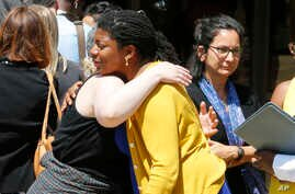 Victims of the 2017 car attack by James Alex Fields Jr., hug outside court after his sentencing in Charlottesville, Va., Friday, June 28, 2019. Fields was sentenced to life in prison for his role in a car attack during a white supremacist rally in…