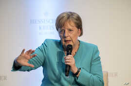 "German Chancellor Angela Merkel takes part in a discussion during an event marking the 60th anniversary of the ""Hessische Kreis"" association in Frankfurt am Main, Germany, Wednesday June 5, 2019. (Thomas Lohnes/Pool via AP)"