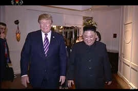 In this image made from video released on Wednesday, March 6, 2019, by North Korean broadcaster KRT, North Korean leader Kim Jong Un, right, smiles while walking with U.S. President Donald Trump for a meeting in Hanoi, Vietnam. North Korea's state…