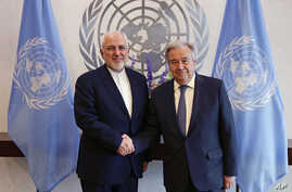 Iranian Foreign Minister Mohammad Javad Zarif, left, shakes hands with U.N. Secretary General Antonio Guterres at United Nations headquarters, July 18, 2019.
