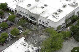 This image taken from video provided by WPLG shows debris covering the parking lot of a shopping center after an explosion on Saturday, July 6, 2019 in Plantation, Fla.  The explosion happened Saturday morning at the shopping center, west of Fort…