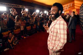 "Donald Glover, a cast member in ""The Lion King,"" poses at the premiere of the film at the El Capitan Theatre, Tuesday, July 9, 2019, in Los Angeles. (Photo by Chris Pizzello/Invision/AP)"