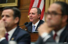 House Intelligence Committee Chairman Adam Schiff, D-Calif.,questions former special counsel Robert Mueller, as he testifies before the House Intelligence Committee hearing on his report on Russian election interference, on Capitol Hill, in…